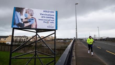 A billboard on the Northside of Dublin urging people to hold on and heralding the arrival of vaccinations. Photo: Brian Lawless/PA Wire