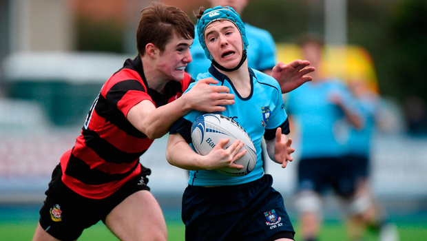 Jeffrey Woods of St. Michael's College is tackled by Adam Strong of Kilkenny College. Photo by Matt Browne/Sportsfile