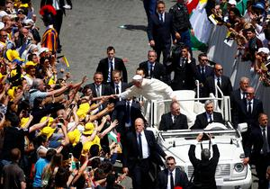 Pope Francis greets the faithful as he leaves at the end of the ceremony for the canonisation of four nuns at Saint Peter's square in the Vatican City, May 17, 2015. The four nuns being canonised include two Palestininan nuns, Marie Alphonsine Ghattas, founder of the first Catholic congregation in Palestine, and Mariam Baouardy Haddad, who established a Carmelite convent in Bethlehem.      REUTERS/Tony Gentile