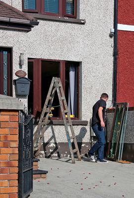 The windows are replaced (after they were removed to allow the large coffin to enter the house) on the house on Mourne Road, Drimnagh where a wake was held for Gerard 'Hatchet' Kavanagh, who was shot dead in Harmons Irish Bar in the Costa del Sol, Spain two weeks ago. Picture Colin Keegan, Collins Dublin.