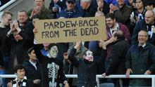 Newcastle fans display a sign in favour of manager Alan Pardew after the match between Newcastle United and Liverpool. Stu Forster/Getty Images