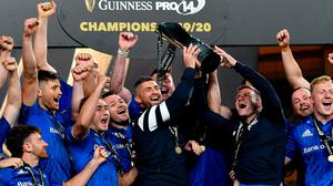 Rob Kearney, left, and Fergus McFadden of Leinster lift the trophy following their victory in the the Guinness PRO14 Final at the Aviva Stadium in Dublin. Photo by Ramsey Cardy/Sportsfile