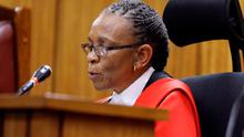 Judge Thokozile Masipa reads her verdict during the trial of Olympic and Paralympic track star Oscar Pistorius at the North Gauteng High Court in Pretoria. REUTERS/Kim Ludbrook