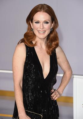 "Actress Julianne Moore attends the Premiere of Lionsgate's ""The Hunger Games: Mockingjay - Part 1"" at Nokia Theatre L.A. Live on November 17, 2014 in Los Angeles, California.  (Photo by Jason Merritt/Getty Images)"