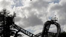An air ambulance flies over the Smiler ride at Alton Towers in Alton, Britain June 2, 2015.  Four teenagers were seriously hurt at one of Britain's biggest theme parks on Tuesday when two carriages collided on a rollercoaster ride, rescue workers said.  REUTERS/Darren Staples