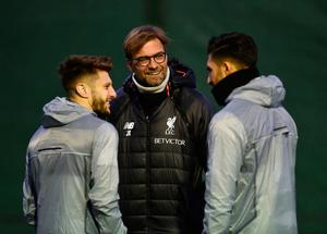 Jurgen Klopp talks to Adam Lallana and Emre Can during Liverpool training at Melwood. Photo: Getty