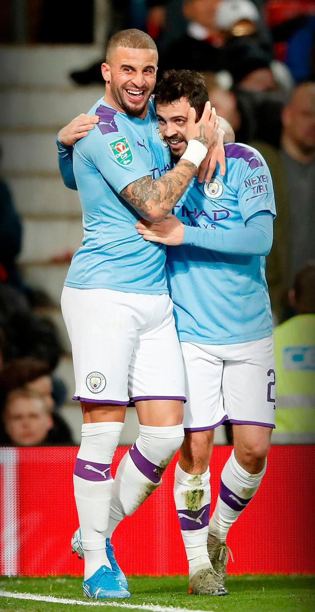 Kyle Walker (l) congratulates Bernardo Silva after he opened the scoring for City. Photo: PA Wire