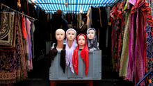 People look at a market stall selling the hijab in east London. Photo: Reuters