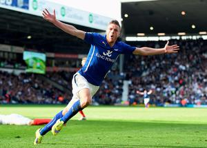 Jamie Vardy of Leicester City celebrates scoring the winner against West Bromwich Albion