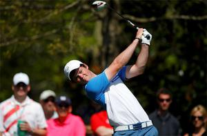 Amateur Alan Dunbar from Northern Ireland hits his tee shot on the seventh hole during a practice round ahead of the US Masters