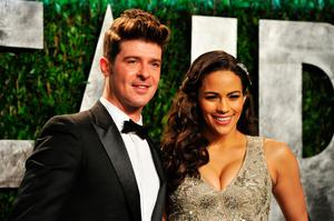Singer Robin Thicke (L) and actress Paula Patton. (Photo by Pascal Le Segretain/Getty Images)