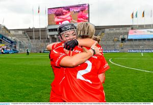 14 September 2014; Cork captain Anna Geary, left, and Joanne O'Callaghan celebrate after the game. Liberty Insurance All Ireland Senior Camogie Championship Final, Kilkenny v Cork, Croke Park, Dublin. Picture credit: Ramsey Cardy / SPORTSFILE