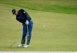 28 May 2015; Graeme McDowell, Northern Ireland, plays his second shot to the 17th green. Dubai Duty Free Irish Open Golf Championship 2015, Day 1. Royal County Down Golf Club, Co. Down. Picture credit: Brendan Moran / SPORTSFILE