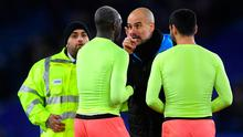 Manchester City manager Pep Guardiola has words with full-back Benjamin Mendy after his team's victory against Leicester City on Saturday. Photo: Laurence Griffiths/Getty Images