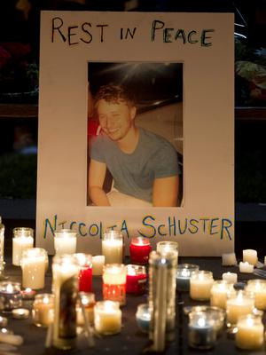 Candles illuminate a picture of Niccolai Schuster during a candlelight vigil for six Irish students Wednesday, June 17, 2015, in Berkeley, Calif. (AP Photo/Beck Diefenbach)