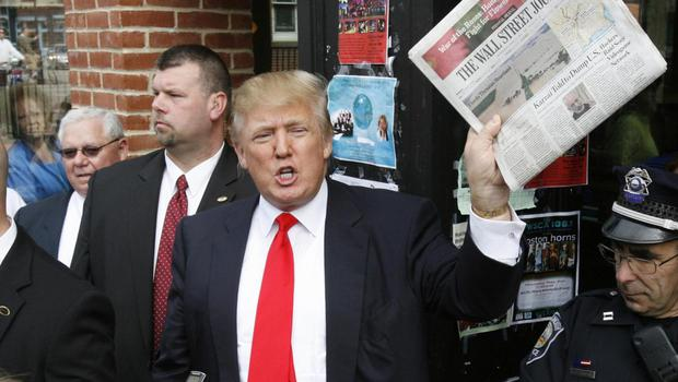 The President brandishing a copy of the Wall Street Journal on the campaign trail Joel Page/Reuters