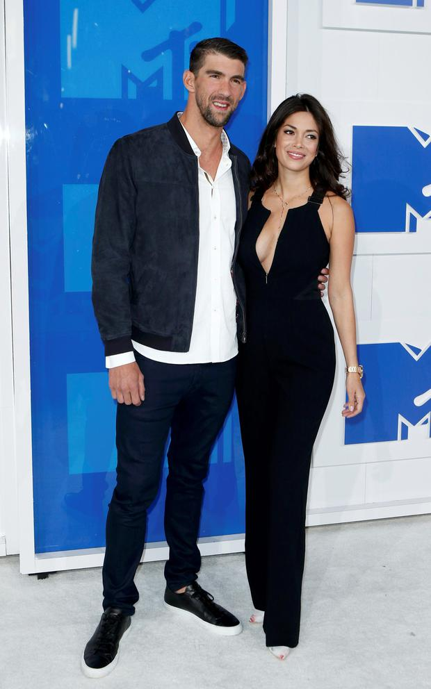 Olympic swimmer Michael Phelps and fiance Nicole Johnson arrive at the 2016 MTV Video Music Awards in New York, U.S., August 28, 2016. REUTERS/Eduardo Munoz