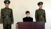 U.S. citizen Matthew Todd Miller sits in a witness box during his trial at the North Korean Supreme Court in this undated photo