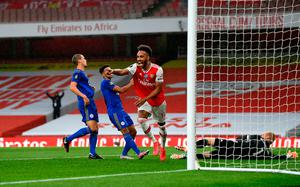 Arsenal's Pierre-Emerick Aubameyang scores his side's opening goal against Leicester