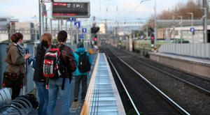 Commuters waiting without success for a DART this morning. Photo: Mark Condren