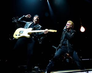 "The Edge and Bono perform onstage during U2's ""iNNOCENCE + eXPERIENCE"" tour at Madison Square Garden on July 23, 2015 in New York City.  (Photo by Kevin Mazur/WireImage)"