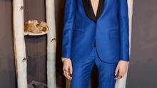 Cara Delevingne wore an electric blue suit at the launch of the Cara Delevingne Collection for Mulberry during London Fashion Week