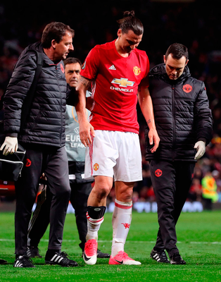 Manchester United's Zlatan Ibrahimovic makes his way off the pitch after suffering a nasty knee injury. Photo: Martin Rickett/PA Wire