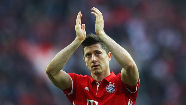 COLOGNE, GERMANY - MARCH 04:  Robert Lewandowski of Bayern Munich celebrates victory in front of the fanes after the Bundesliga match between 1. FC Koeln and Bayern Muenchen at RheinEnergieStadion on March 4, 2017 in Cologne, Germany.  (Photo by Dean Mouhtaropoulos/Bongarts/Getty Images)