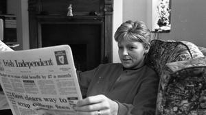 Veronica Guerin reading the Irish Independent shortly before her murder on June 26, 1996. Photo: David Conachy