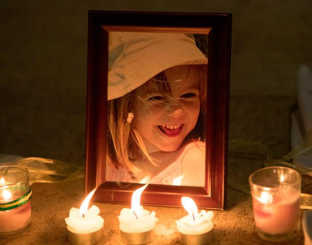 Candles are placed next to a photo of Madeleine McCann inside the Church of Nossa Senhora da Luz in Praia Da Luz, Portugal, in 2017, where a special service was held to mark the 10th anniversary of her disappearance. Photo: Steve Parsons/PA Wire