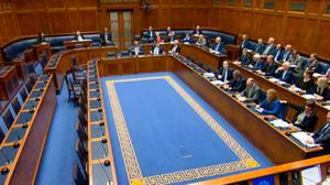 A video grab from NI Assembly TV showing a half empty debating chamber at the Stormont Assembly in Belfast, as it sat for the first time in two and half years after it was recalled by MLAs wishing to protest at changes to Northern Ireland's abortion laws. PA Photo