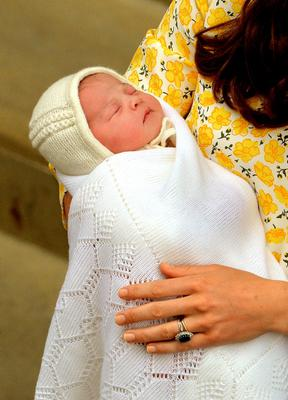 Princess of Cambridge in the arms of her mother the Duchess of Cambridge outside the Lindo Wing of St Mary's Hospital in London. PRESS ASSOCIATION Photo. Picture date: Saturday May 2, 2015. See PA story ROYAL Baby. Photo credit should read: John Stillwell/PA Wire