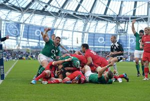 Cian Healy celebrates after team-mate Chris Henry scored Ireland's first try in their Six Nations win over Wales at the Aviva Stadium