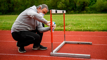 Donore Harriers coach Paul Clarkin sanitises a hurdle yesterday.