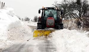A snow plough clears the Carnlough to Ballymena road in Co Antrim after a heavy snowfall
