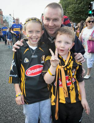 Katie Graham 9, David Buggy & Connor Buggy 6 all from Kilkenny  at the All Ireland Hurling Final between Kilkenny & Tipperary at Croke Park, Dublin. Photo:  Gareth Chaney Collins