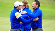 Graeme McDowell and Rory McIlroy celebrate on the 17th hole during the singles matches of the 2014 Ryder Cup