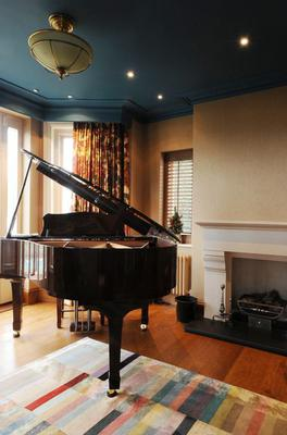 A grand piano sits  in the reception room