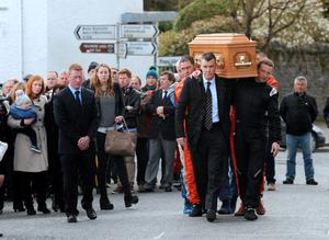 The coffin of Simon McKinley being carried from The Seamus Ennis Centre to the graveyard. Naul, Co. Dublin. Picture: Caroline Quinn