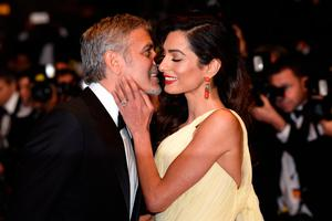 "Actor George Clooney and his wife Amal Clooney attend the ""Money Monster"" premiere during the 69th annual Cannes Film Festival at the Palais des Festivals on May 12, 2016 in Cannes, France.  (Photo by Clemens Bilan/Getty Images)"
