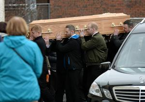 14 March 2017;  General view of coffin being carried into the church. Funeral of Karl Robertson. St. Luke the Evangelist Church, Kilmore West, Coolock, Dublin. Picture: Caroline Quinn