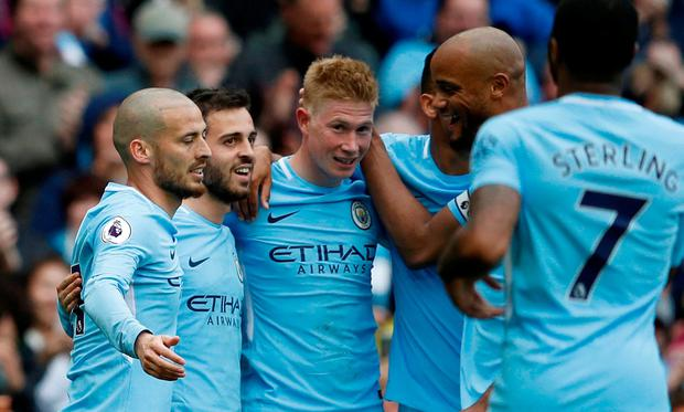 Manchester City's Kevin De Bruyne celebrates scoring their third goal with teammates. REUTERS/Phil Noble