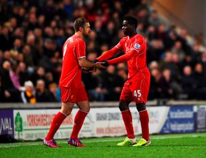 HULL, ENGLAND - APRIL 28:  Mario Balotelli of Liverpool shakes hands with Rickie Lambert as he is substituted during the Barclays Premier League match between Hull City and Liverpool at KC Stadium on April 28, 2015 in Hull, England.  (Photo by Laurence Griffiths/Getty Images)