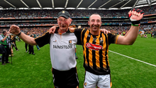 Kilkenny's Eoin Larkin with manager Brian Cody following their victory over Galway.