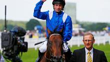 Dane O'Neill riding Muhaarar celebrates winning the 15.40 Commonwealth Cup