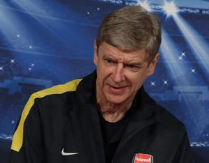Arsenal manager Arsene Wenger arrives for a news conference prior to the Champions League, round of 16, second leg soccer match between FC Bayern Munich and Arsenal London, in Munich, Germany, Tuesday, March 12, 2013. (AP Photo/Matthias Schrader)