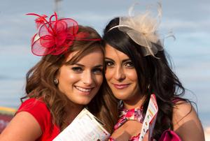Cliona Molloy from Offaly and Kim Duffy from Kildare enjoying the first day of the Galway racing festival. Pic:Mark Condren