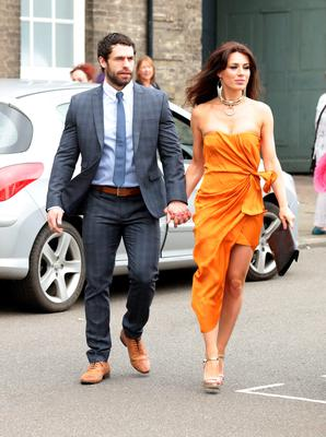 Kelvin Fletcher and  Liz Marsland , make their way to St Mary's Church in Bury St Edmunds, Suffolk, for the wedding of former Coronation Street actress Michelle Keegan to The Only Way Is Essex star Mark Wright.  Yui Mok/PA Wire