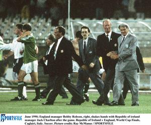 June 1990; England manager Bobby Robson, right, shakes hands with Republic of ireland manager Jack Charlton after the game. Republic of Ireland v England, World Cup Finals, Caglairi, Italy. Soccer. Picture credit; Ray McManus / SPORTSFILE