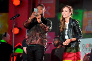 Recording Artist, Usher, and Actress Olivia Wilde on stage at the 2015 Global Citizen Festival to end extreme poverty by 2030 in Central Park on September 26, 2015 in New York City.  (Photo by Theo Wargo/Getty Images for Global Citizen)